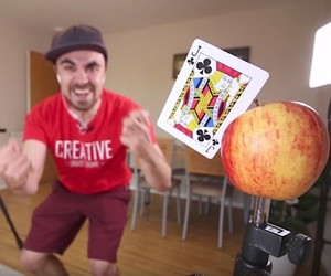 Mike Boyd learns to throw playing cards on apples