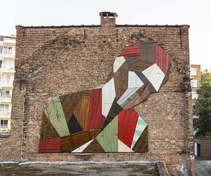 Strook hangs geometric wooden heads on house walls