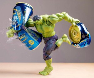 Superhero Action Figures Arranged in Scenarios