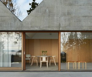 Concrete and Glass Space With Pitched Roof