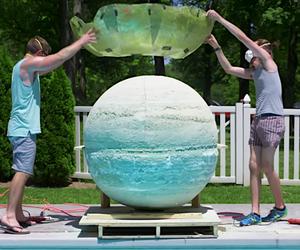 Throw huge bathing ball into a pool