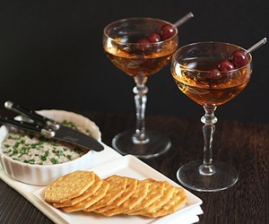 A Classic Manhattan Served with Mushroom Paté