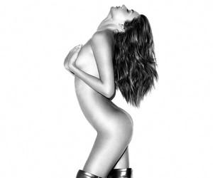 Miranda Kerr Strips for the September Issue Harper