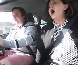 A novice driver next to his parents