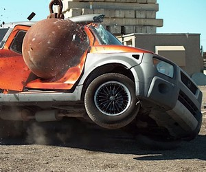 In slow motion: a wrecking ball against four cars