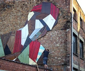 """Elsewhere"" Street Murals made of discarded Doors"