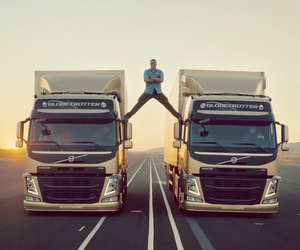 JEAN-CLAUDE VAN DAMME MAKES EPIC SPLIT ON TRUCKS!