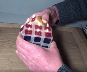 Tony Fisher releases a burning wax magic cube